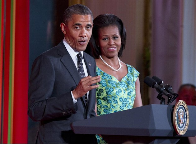 "President Barack Obama, accompanied by first lady Michelle Obama, speaks during Kids' ""State Dinner,""  hosted by Mrs. Obama, Monday, Aug. 20, 2012, in the East Room of the White House in Washington (A"