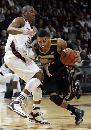 English leads No. 3 Missouri over A&M 71-62