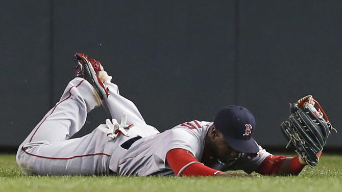 Boston Red Sox left fielder Hanley Ramirez makes a diving catch on a shallow fly ball by Minnesota Twins' Kurt Suzuki in the eighth inning of a baseball game, Tuesday, May 26, 2015, in Minneapolis. The Twins won 2-1. (AP Photo/Jim Mone)