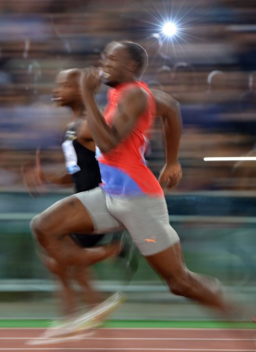 Jamaica's Usain Bolt (C) competes to win