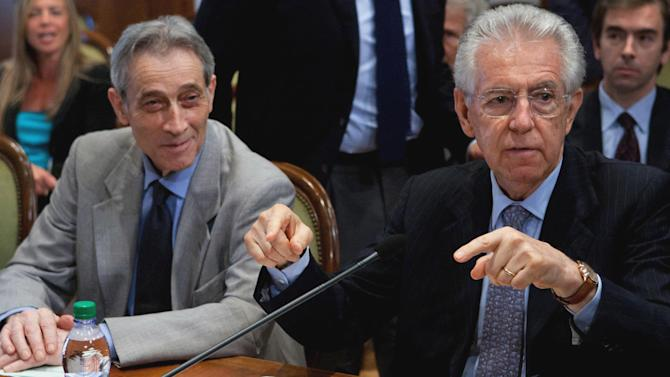 Italian Premier Mario Monti, right, flanked by Enrico Bondi gestures during a meeting to outline details on the spending review in Rome, Tuesday, July 3, 2012. Bondi has the task of deciding what cuts are carried out in which ministries. Bondi is the Italian turnaround expert who helped restructure the Parmalat dairy empire after its collapse in fraudulent bankruptcy last decade. (AP Photo/Roberto Monaldo, Lapresse)