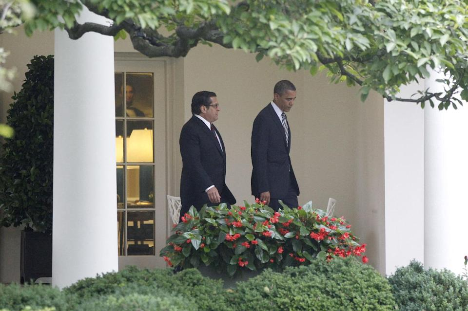 President Barack Obama walks from the Oval Office the White House in Washington, Friday, June 1, 2012, with Rep. Steven Rothman, D-N.J., as he travels to Minneapolis and Chicago. (AP Photo/Charles Dharapak)