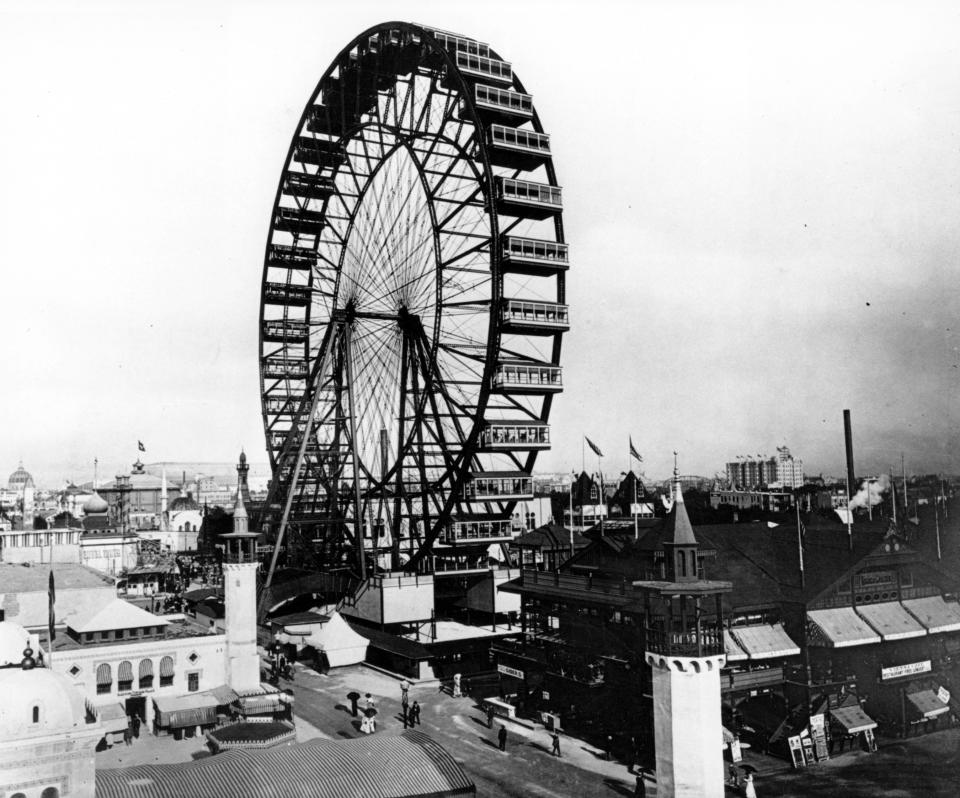 In this May 1893 photo, the first Ferris wheel, which was capable of carrying 1,400 persons, and rose 250 feet into the air, looms over the grounds of the 1893 World's Columbian Exposition in Chicago, Ill. (AP Photo)