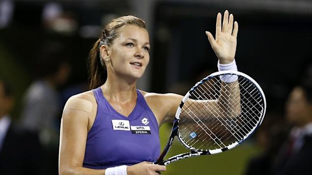 Agnieszka Radwanska of Poland waves to spectators after defeating Angelique Kerber of Germany during their semi-final singles match at the Pan Pacific Open (Reuters)