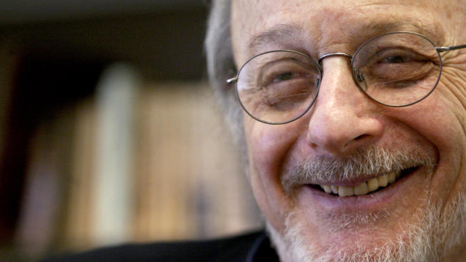 """FILE - In this April 27, 2004 file photo, author E.L. Doctorow smiles during an interview in his office at New York University. The Prague Writers' Festival opens in Pittsburgh on Friday, Oct. 18, 2013, the first time the event is being held in the United States. E.L. Doctorow, known for works including """"Ragtime"""" and """"Billy Bathgate, is slated to read excerpts of his new novel, """"Andrew's Brain,"""" at the festival. (AP Photo/Mary Altaffer, File)"""