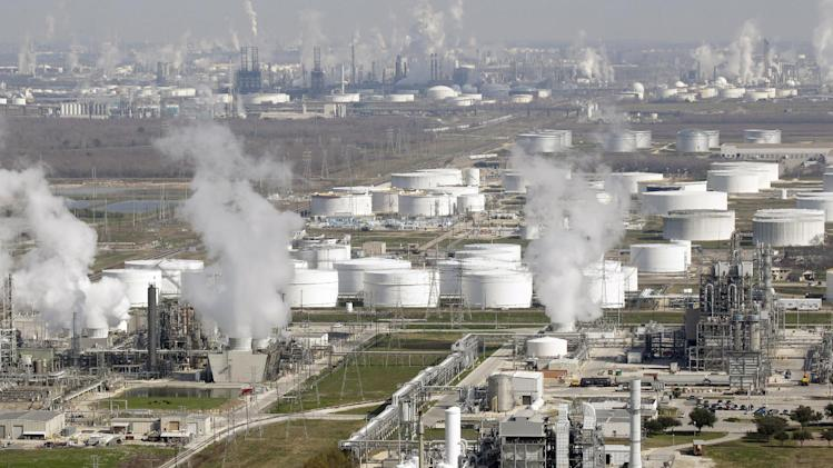 FILE - In this Nov. 10, 2010 file photo, oil refineries are shown in this aerial view, in Deer Park, Texas. For the first time, the top export of the United States, the world's biggest gas guzzler, is _ wait for it _ fuel. (AP Photo/David J. Phillip, File)