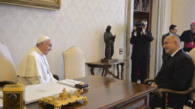 Pope Francis talks with Bulgaria's Prime Minister Borissov during a private audience in the pontiff's studio at the Vatican