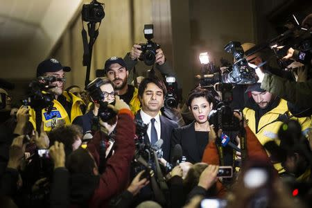 Canadian celebrity radio host Jian Ghomeshi leaves court after getting bail on multiple counts of sexual assault in Toronto