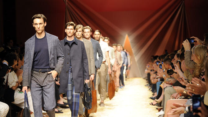 Models on parade at the end of the Missoni men's Spring-Summer 2014 collection, part of the Milan Fashion Week, unveiled in Milan, Italy, Sunday, June 23, 2013. (AP Photo/Giuseppe Aresu)