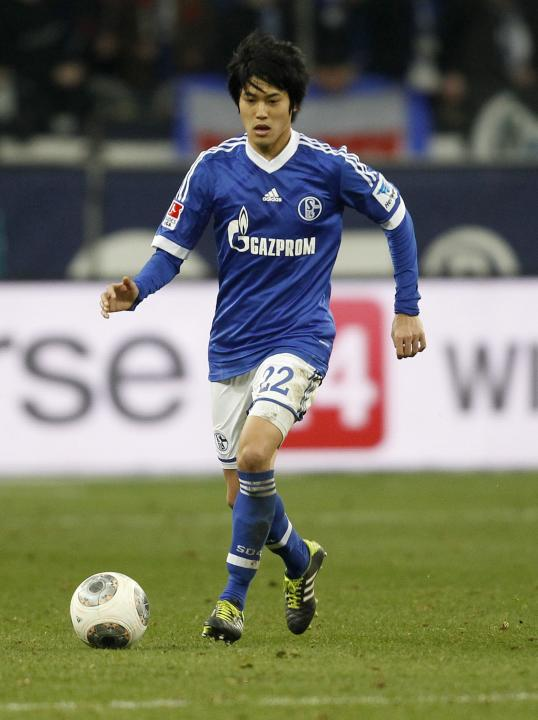 Schalke 04's Uchida plays a ball during the German first division Bundesliga soccer match against Hanover in Gelsenkirchen