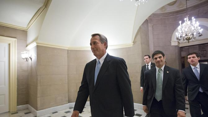 Speaker of the House John Boehner, R-Ohio, walks to the chamber for the final vote as the House of Representatives passes a $50.7 billion emergency aid bill for states hit by Superstorm Sandy, Tuesday, Jan. 15, 2013, at the Capitol in Washington. (AP Photo/J. Scott Applewhite)