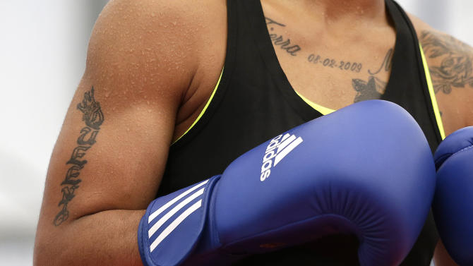 In this Thursday, July 26, 2012 photo, United States' 60-kg lightweight boxer Queen Underwood trains during a practice session at the 2012 Summer Olympics, in London. Women's boxing is an Olympic sport for the first time in London, taking over the ring for a five-day tournament ending in its first three gold medals Thursday. (AP Photo/Patrick Semansky)