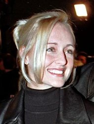 Country music singer Mindy McCready attends the premiere of the horror film &quot;Scream 2&quot; at Mann&#39;s Chinese Theatre in Hollywood in this December 10, 1997 file photograph. REUTERS/Fred Prouser/Files