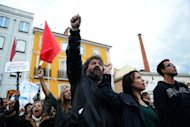 <p>Demonstrators take part in a protest against the Portuguese government's 2013 austerity budget, near the Parliament in Lisbon. The Portuguese parliament adopted on Wednesday a 2013 austerity budget that includes draconian tax increases required by international creditors.</p>