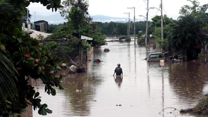 View of a flooded street in Acapulco, Guerrero state, Mexico, on September 26, 2013