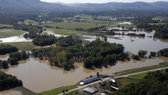 FILE - In this Aug. 30, 2011 file photo, farmer's fields are still flooded in this aerial view on Tuesday, Aug. 30, 2011 in Rutland, Vt.  As the soggy Northeast tries to dry out from flooding and Texas prays for rain that doesn't come, it seems like an ideal match of oversupply and unquenchable demand. It isn't. (AP Photo/Toby Talbot, File)