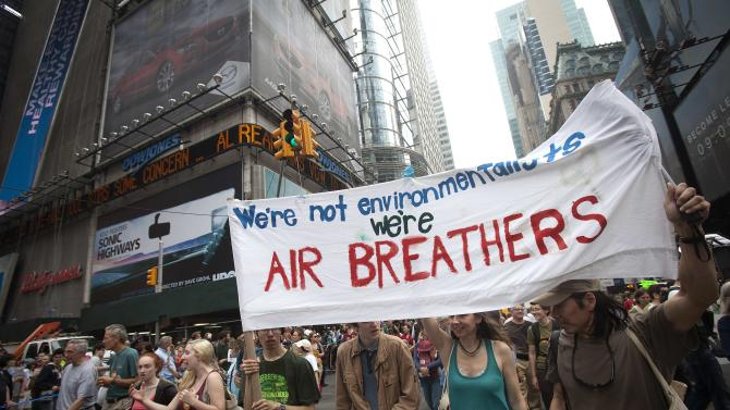 """Protesters walk though Times Square as they take part in the """"People's Climate March"""" down 6th Ave. in the Manhattan borough of New York"""