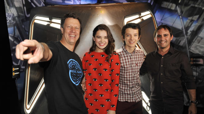 "Gavin Hood, far left, director of the forthcoming film ""Ender's Game,"" poses with, left to right, cast members Hailee Steinfeld and Asa Butterfield and producer Bob Orci at a preview event for the film at the 2013 Comic-Con International Convention on Wednesday, July 17, 2013 in San Diego, Calif. (Photo by Chris Pizzello/Invision/AP)"