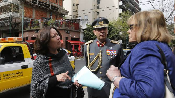 Cuthbert, Servini de Cubria and Rodriguez talk during a ceremony honouring the memory of Carlos Prats on the 40th anniversary of his death in Buenos Aires