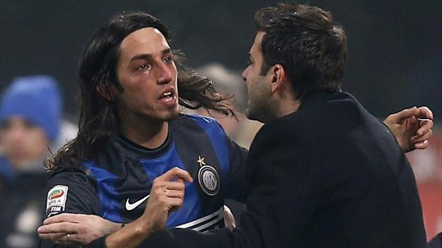 Inter Milan's Ezequiel Schelotto (L) cries as he celebrates with coach Andrea Stramaccioni after scoring against AC Milan during their Italian Serie A match at the San Siro Stadium in Milan