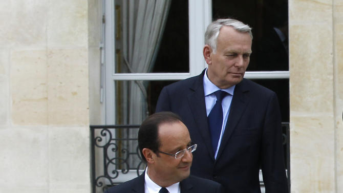 President Francois Hollande, followed by Prime Minister Jean-Luc Ayrault, arrives for the family picture after the weekly cabinet meeting, Thursday, May 17, 2012 at the Elysee Palace in Paris.  (AP Photo/Michel Euler)