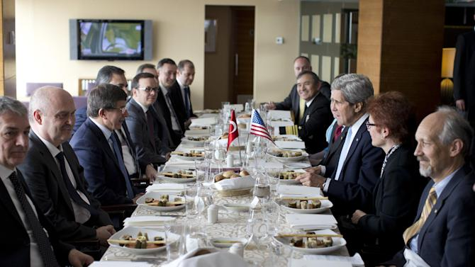Turkish Foreign Minister Ahmet Davutoglu, third from left, meets with U.S. Secretary of State John Kerry, third from right, on Sunday, April 21, 2013, in Istanbul, Turkey. Kerry is wrapping up a 24-hour visit to Istanbul with talks aimed at improving ties between Turkey and Israel and pushing ahead with Mideast peace efforts. (AP Photo/Evan Vucci, Pool)