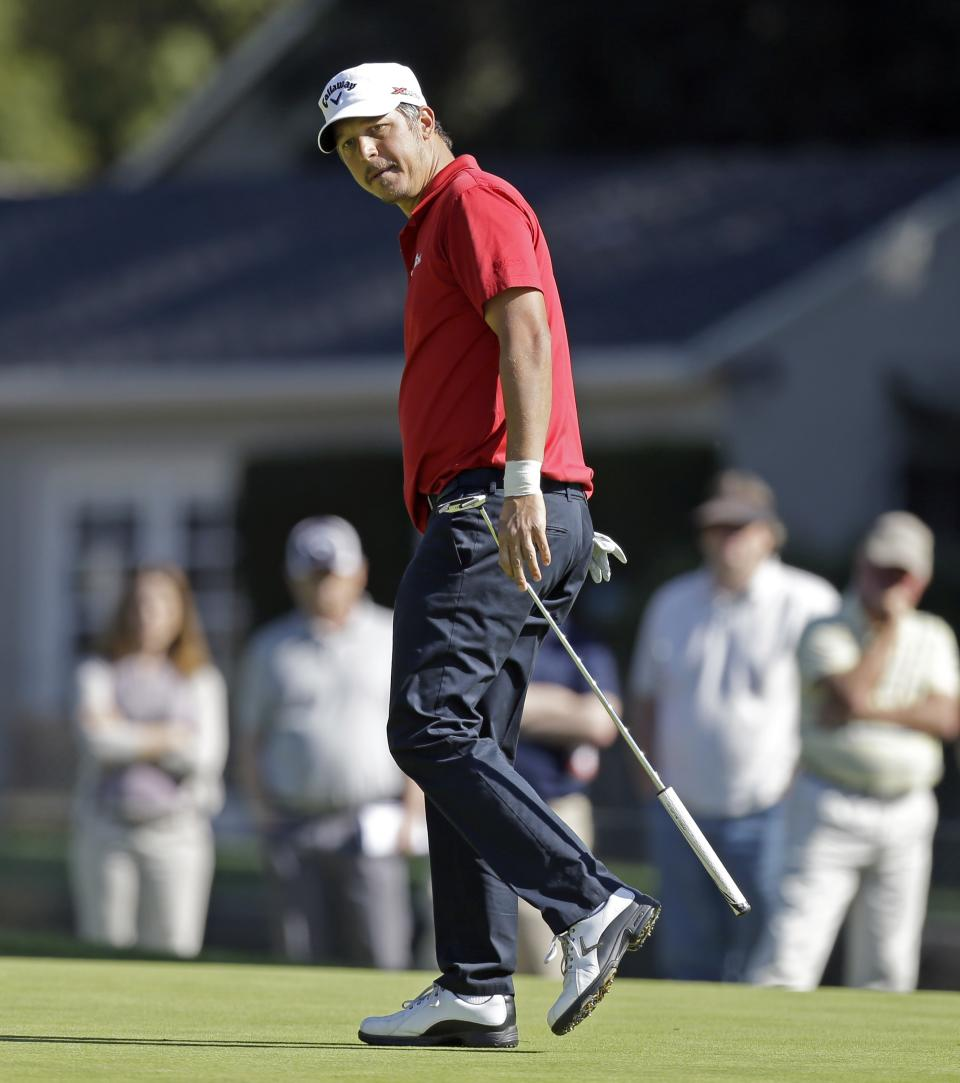 Fredrik Jacobson, of Sweden, watches his eagle putt miss and makes birdie on the first green in the final round of the Northern Trust Open golf tournament at Riviera Country Club in the Pacific Palisades area of Los Angeles, Sunday, Feb. 17, 2013. (AP Photo/Reed Saxon)
