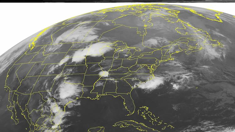 This NOAA satellite image taken Sunday, May 6, 2012 at 1:45 a.m. EDT shows clouds pop up across the Central US as a trough of low pressure strengthens in the Plains. This system pulls moisture and energy in from the Gulf of Mexico and creates a warm front that produces severe thunderstorms across the Upper Midwest.  At the same time, a cold front stretches southward from this system, bringing showers and thunderstorms to the Southern Plains as it moves eastward throughout the day.  (AP PHOTO/WEATHER UNDERGROUND)