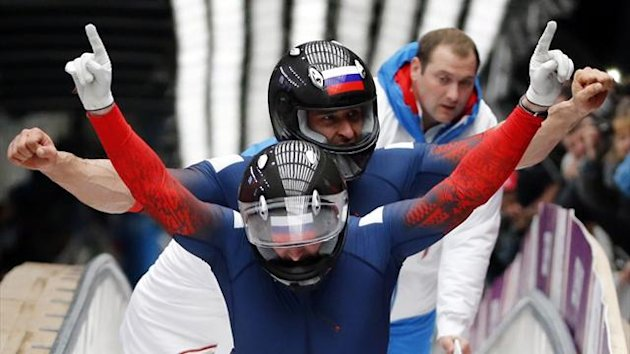 Russia's pilot Alexander Zubkov and Alexey Voevoda celebrate after completing the final run of the men's two-man bobsleigh (Reuters)