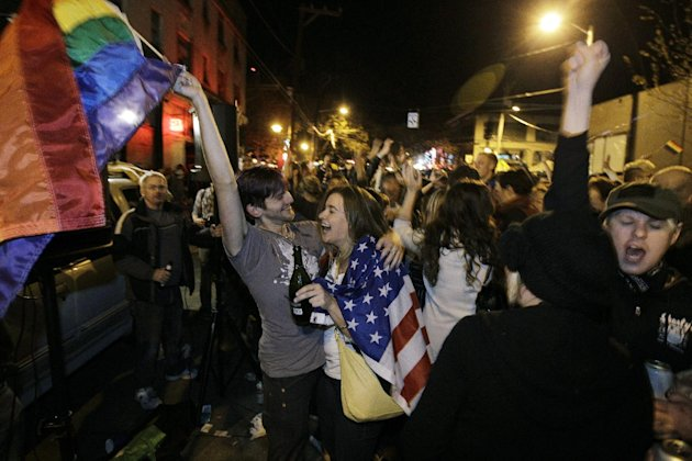 Revelers display U.S. and gay pride flags as they celebrate early election returns favoring Washington state Referendum 74, which would legalize gay marriage, during a large impromptu street gathering in Seattle&#39;s Capitol Hill neighborhood, in the early hours of Wednesday, Nov. 7, 2012. For years, foes of same-sex marriage had a potent talking point: They&#39;d won every time the issue went to a popular vote. That winning streak has now been shattered in a multi-state electoral sweep by gay marriage supporters. It&#39;s a historic tipping point likely to influence other states and possibly even the Supreme Court. (AP Photo/Ted S. Warren)