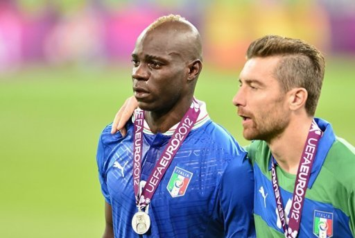 Italian forward Mario Balotelli (L) cries after receiving his silver medal