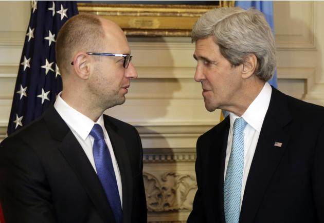 U.S. Secretary of State John Kerry speaks with Ukraine Prime Minister Arseniy Yatsenyuk at the State Department in Washington
