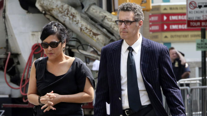 "Actor John Turturro, right, leaves the Cathedral Church of Saint John the Divine after the funeral service for James Gandolfini, Thursday, June 27, 2013 in New York. Gandolfini, who played Tony Soprano in the HBO show ""The Sopranos"", died while vacationing in Italy last week. (AP Photo/Mary Altaffer)"
