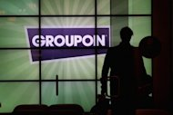 Daily deals site Groupon on Wednesday issued its first earnings report as a publicly traded company, saying its loss in the quarter shrank to about $43 million as revenue nearly tripled from a year earlier