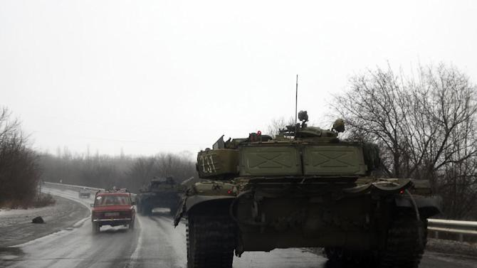 Tanks of pro-Russian separatists drive towards the eastern Ukrainian city of Donetsk on January 22, 2015