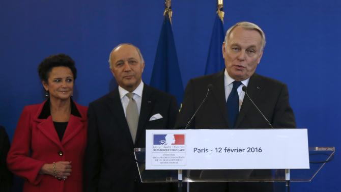 Newly-appointed French Foreign Minister Jean-Marc Ayrault delivers a speech as outgoing Foreign Minister Laurent Fabius listens to during the official handover ceremony at the Quai d'Orsay in Paris