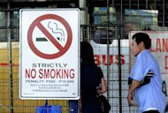 A no smoking sign is seen at a bus terminal in Manila on July 1. Anti-smoking measures have become so widespread that they now affect some 3.8 billion people -- just over half the world's population, the World Health Organization said Thursday