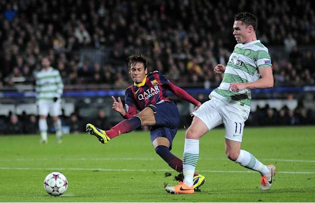 FC Barcelona's Neymar, from Brazil, left, duels for the ball against Celtic's Derk Boerrigter during a Champions League soccer match group H at the Camp Nou in Barcelona, Spain, Wednesday, Dec