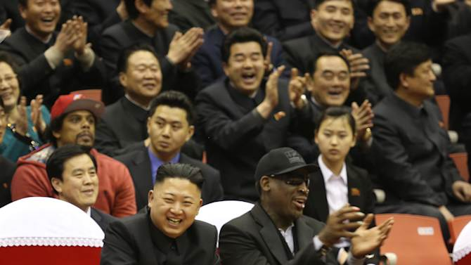 "FILE - In this Feb. 28, 2013 file photo, North Korean leader Kim Jong Un, left, and former NBA star Dennis Rodman watch North Korean and U.S. players in an exhibition basketball game at an arena in Pyongyang, North Korea. Rodman showed Kim Jong Un some of the finer points of basketball, and the North Korean ruler was so impressed he raided the country's stock of fine food and drink for a party that lasted well into the night. ""Guess what, I love him,'' the clearly smitten Rodman said. ""The guy's really awesome."" (AP Photo/VICE Media, Jason Mojica, File)"