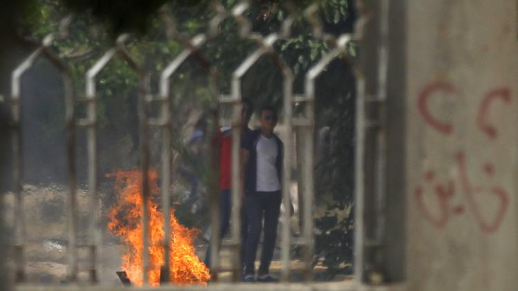Students who are supporters of Muslim Brotherhood and ousted Egyptian President Mohamed Mursi make a fire in Cairo's Nasr City