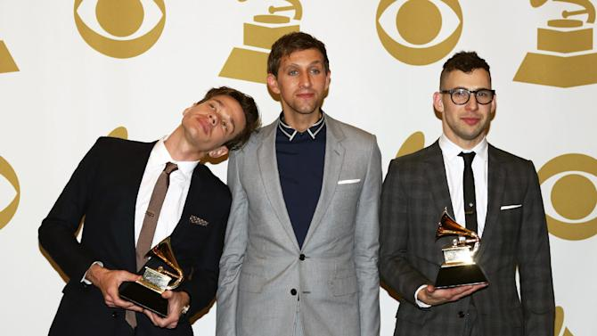 """Members of fun., from left, Nate Ruess, Andrew Dost and Jack Antonoff, pose backstage with the song of the year award for """"We Are Young"""" at the 55th annual Grammy Awards on Sunday, Feb. 10, 2013, in Los Angeles. (Photo by Matt Sayles/Invision/AP)"""
