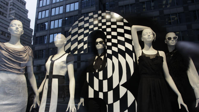 Mannequins are fashionably dressed in a Bloomingdale's store window, Thursday, Oct. 13, 2011 in New York. U.S. consumers stepped up their spending on retail goods in September, a hopeful sign for the sluggish economy. (AP Photo/Mark Lennihan)