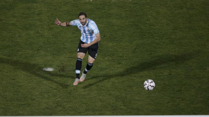 Argentina's Gonzalo Higuain fails to score on his penalty kick during a shootout against Chile in their Copa America 2015 final soccer match at the National Stadium in Santiago