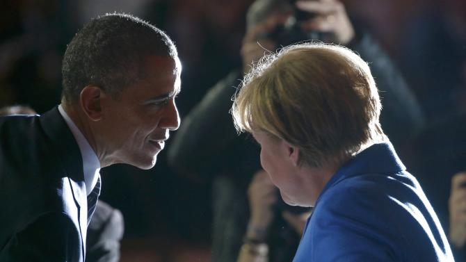 US President Obama talks to German Chancellor Merkel during the opening session of the World Climate Change Conference 2015 (COP21) at Le Bourget, near Paris