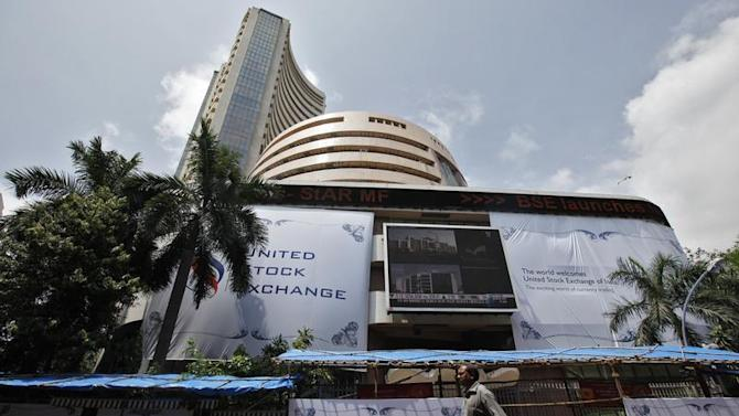 A man walks past the BSE building in Mumbai