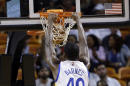 Golden State Warriors forward Harrison Barnes (40) dunks over Miami Heat guard Norris Cole (30) and forward Luol Deng (9) in the first half of an NBA basketball game, Tuesday, Nov. 25, 2014, in Miami. (AP Photo/Lynne Sladky)