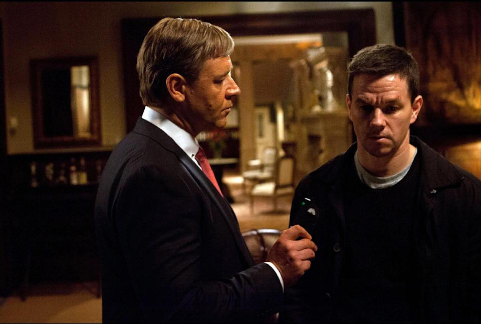 "This film image released by 20th Century Fox shows Russell Crowe, left, and Mark Wahlberg in a scene from ""Broken City."" (AP Photo/20th Century Fox, Barry Wetcher)"