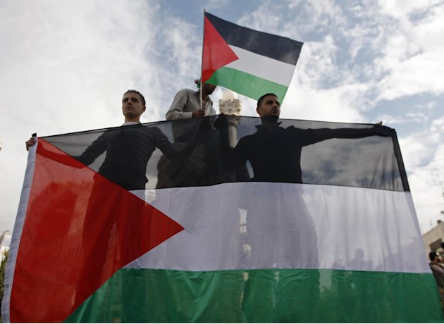 Palestinians celebrate what they call a victory over Israel, in the West Bank city of Ramallah, Thursday, Nov. 22, 2012. Eight days of punishing Israeli airstrikes on Gaza and a barrage of Hamas rocke