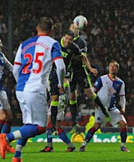 Wigan Athletic&#39;s Paraguayan defender Antoln Alcaraz (3rd R) heads the only goal of the game during the English Premier League football match between Blackburn Rovers and Wigan Athletic at Ewood Park, Blackburn. Blackburn Rovers were relegated from the Premier League on Monday after a 1-0 defeat at home to Wigan Athletic ended their 11-year stay in the top flight