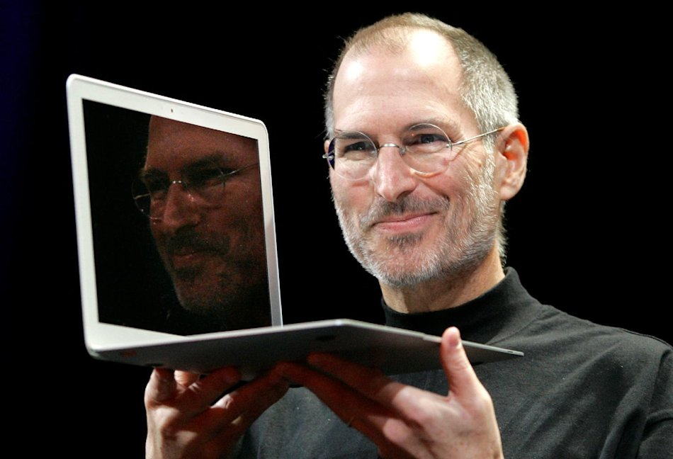 2008 - Apple CEO Steve Jobs holds up the new MacBook Air after giving the keynote address at the Apple MacWorld Conference in San Francisco. Apple on Wednesday, Oct. 5, 2011 said Jobs has died. He was